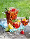 Refreshing fruit sangria punch on wood table Stock Photo