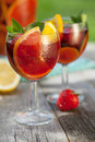 Refreshing fruit sangria punch on wood table Stock Image