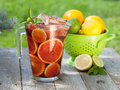 Refreshing fruit sangria punch on wood table Royalty Free Stock Images