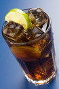 Refreshing glass of cola with lemon and ice Royalty Free Stock Photo