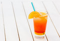 Refreshing glass of natural orange juice placed on wooden white table Royalty Free Stock Photos