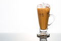 Refreshing ice cold coffee with milk in transparent glass Royalty Free Stock Photo