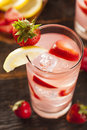 Refreshing ice cold strawberry lemonade on a background Royalty Free Stock Photos