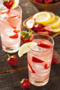 Refreshing ice cold strawberry lemonade on a background Royalty Free Stock Image