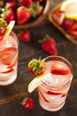 Refreshing ice cold strawberry lemonade on a background Stock Image