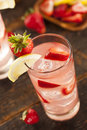 Refreshing ice cold strawberry lemonade on a background Royalty Free Stock Images