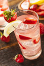 Refreshing ice cold strawberry lemonade on a background Stock Photography