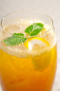 Refreshing ice tea closeup macro with lemon and mint leaves Royalty Free Stock Photo