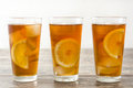 Refreshing iced tea with lemon on wood Royalty Free Stock Photo