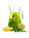 Refreshing punch pitcher with a drink tarhun with lemon slices on white background Royalty Free Stock Image