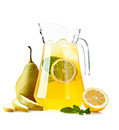 Refreshing punch pitcher with a duchess pear with fruit on a white background Stock Images