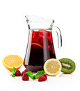 Refreshing punch pitcher with a fruit on a white background Stock Photos
