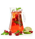 Refreshing punch pitcher with a raspberry mojito with fresh mint and strawberries on a white background Stock Images