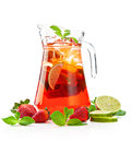 Refreshing punch pitcher with a strawberry mojito with fresh mint and strawberries on a white background Royalty Free Stock Photos