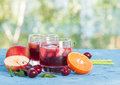 Refreshing sangria or punch with fruit fruits in glasses Stock Photography