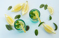 Refreshing summer drink with lemon ice and mint slices leaves Stock Images