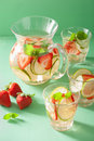 Refreshing summer drink with strawberry cucumber lime in jar and Royalty Free Stock Photo