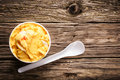 Refreshing tangy citrus ice cream or sorbet takeaway tub of delicious served with a disposable plastic spoon on an old weathered Royalty Free Stock Photo