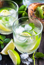 Refreshing traditional cuban mojito with fresh lime and mint Stock Photography
