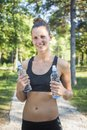 Refreshing after a workout girl is with water training Royalty Free Stock Photo