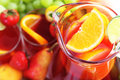 Refreshment beverage in pitcher with fruits Royalty Free Stock Image