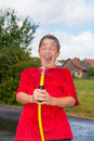 Refreshment boy is playing with a hosepipe Royalty Free Stock Image
