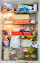 Refrigerator dirty full and very Stock Photo