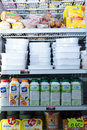 Refrigerator shelves with different chilled products barcelona spain march such as butter and milk at average polish supermarket Stock Images