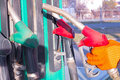 Refueling point worker taking the gas nozzle out of a vehicle after filling up a gas tank on a gas station photograpy Royalty Free Stock Image