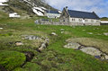 Refuge and farmers house in maillet plateau in french pyrenees high mountain green spring grass is at foreground hautes Stock Images