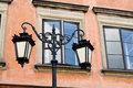 Refurbished fragment of ancient buildings in warsaw and lantern Royalty Free Stock Images