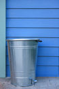 Refuse bin and blue wall Stock Photo