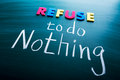 Refuse to do nothing conceptual words on blackboard Royalty Free Stock Photo