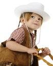 Regarder vers le haut une jeune cow-girl d'équitation Photos stock