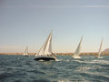 The regatta maneuvers yachts at sea during Royalty Free Stock Photography