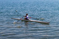 Regatta skulls rowing race girl teenager athlete single canoe time trial Royalty Free Stock Image
