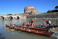 Regatta on tiber river rome italy may annual with the mausoleum of hadrian in the background Royalty Free Stock Photo