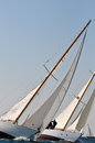 Regatta two yachts engaged in a sailing race with another in background Stock Photo