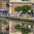 The Regent's Canal runs through an area of ongoing regeneration with new apartment buildings Royalty Free Stock Photo