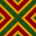 Reggae colors crochet knitted style background, top view. Collage with mirror reflection. Seamless kaleidoscope montage