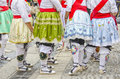 Regional traditional costumes detail of of a group of women on the street Royalty Free Stock Photo