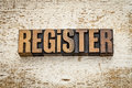Register word in wood type vintage letterpress on a grunge painted barn background Royalty Free Stock Photo