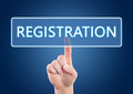 Registration hand pressing button on interface with blue background Royalty Free Stock Photography