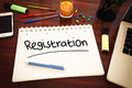Registration handwritten text in a notebook on a desk d render illustration Royalty Free Stock Photo