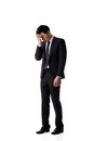 Regret young business ma man standing and thinking full length portrait isolated Stock Photography