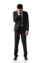 Regret young business man standing and thinking full length portrait isolated on white background Stock Image