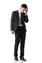 Regret young business man standing and thinking full length portrait isolated on white background Stock Photos