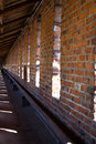 Regular pattern brick wall with windows roof and sunspots forming taken in nizhny novgorod kremlin Stock Image