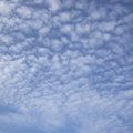 Regular pattern of fluffy clouds in blue sky Stock Photos