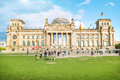 Reichstag in berlin front view of on sunny day with people around Stock Photo